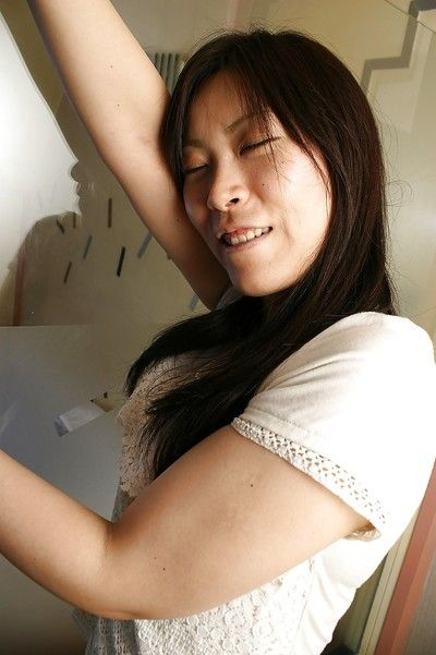 Shy asian chick strips down and showcases her hairy twat in close up