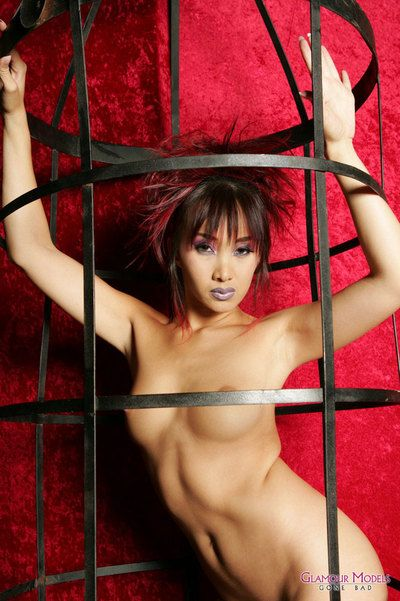 Tight bodied flirtatious asian model Katsumi poses in tight latex mini skirt and naked