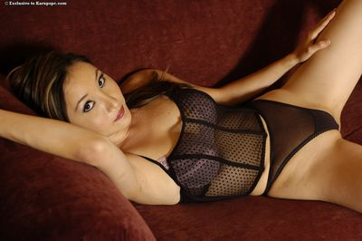 Asian model Lacey Tom in black lingerie smokes a cigarette and shows her shaved snatch