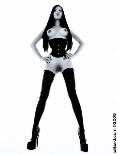 Asian Jade Vixen in thigh high latex boots and corset makes no secret of her tits and snatch