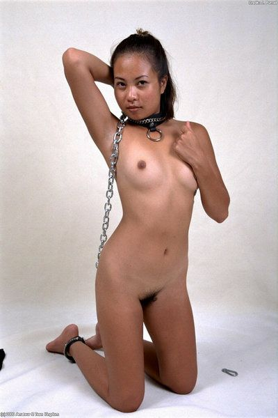Kinky Asian amateur Jennifer modeling in chains and ball gag