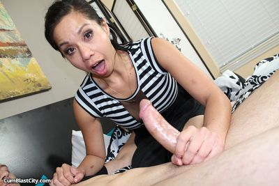 Smiling Asian bimbo Kimmy Lee goes topless and starts wanking the ram rod