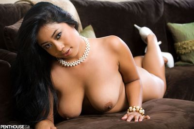 Chubby Asian doll Kya Tropic demonstrates naked tits and poses in white panty