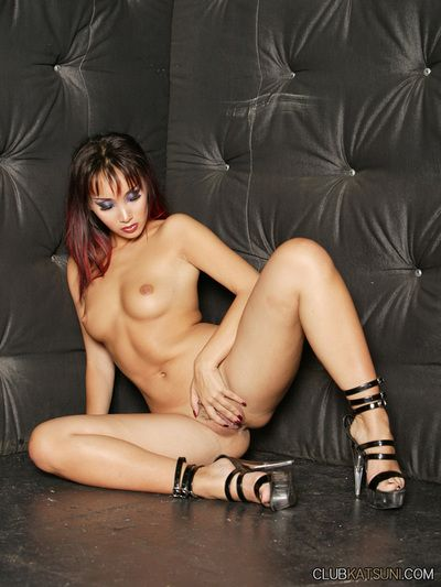 Shameless asian babe Katsuni removes her red latex dress and spreads her legs