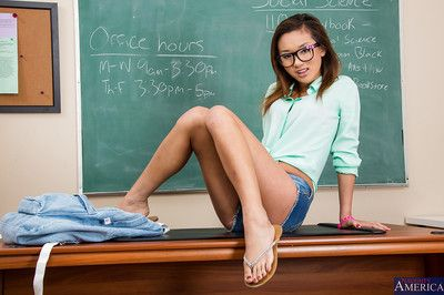 Sexy schoolgirl Alina Li is posing in her glasses on a table