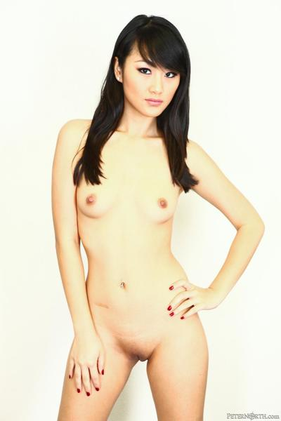 Enjoy the naked Asian girl Evelyn Lin showing off her pussy and small boobs