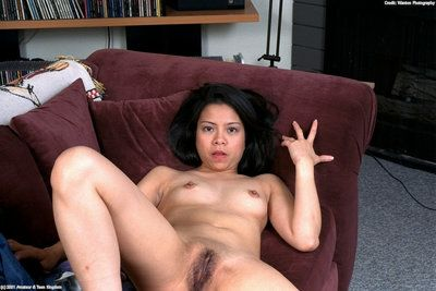 Dark-haired Asian babe Peggy cannot stop rubbing her insatiable hairy twat