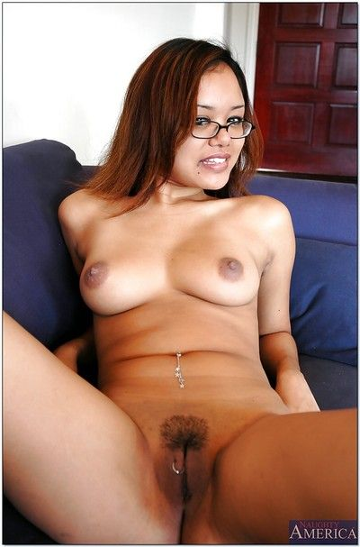 Cute asian babe in glasses Annie Cruz showing off trimmed pussy
