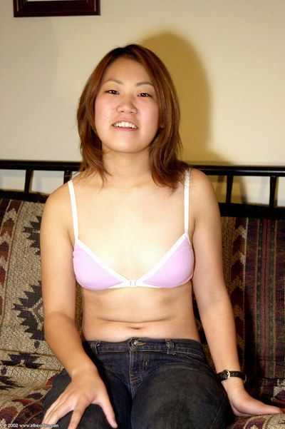 Oriental first timer Naoko strips off jeans to reveal nice ass and beaver