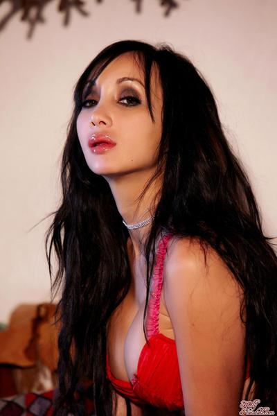 The red lingerie of Asian chick Katsuni is off uncovering beautiful big boobs