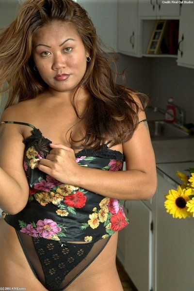 Asian amateur Tina displaying small tits while disrobing in kitchen