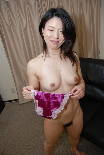 Undressing Asian Takako Kitajima caught on camera while spreading her legs