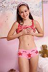Cute Asian teen Amai Liu pinching the nipples and shyly showing the cunt