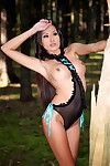 Asian outdoors in sheer lingerie has time to show us tits and pussy