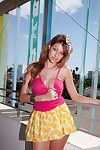 Titsy youthful model Bobbi Vidal flashes her underwear in outdoor public session
