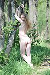 Hot adolescent struts around in her dress, panties, and the nude outdoors
