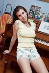 Alluring teen is dirty and eager to have some approval during posing her panties and feet