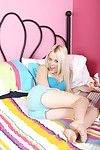 Pale skinned slim blond Rebecca Blue removes her blue lingerie and fingers her adolescent pussy in bed