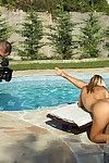 Pigtailed blonde Nikky Thorne loses her bikini and divulges her appealing without clothes body beside the pool