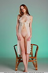 Carnal brunette hair babe Indiana A takes her clothes off to dribble her skinhead gentile