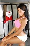 Ebony athlete Rihanna Rimes strips her tight sports uniform in the locker room