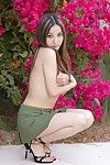 High heeled cutie Lacey Tom in short unpracticed petticoat shows it all whereas posing outside