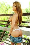 Rounded Oriental Kt So location in sneakers and jean underwear outdoors