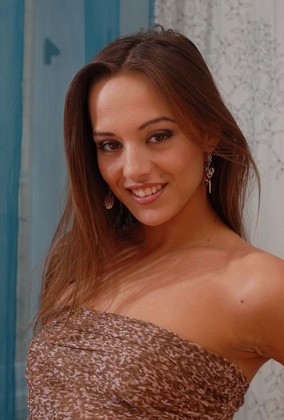 Gorgeous and naked solo teen Dominika is demonstrating their way sexy figure beside the room