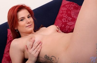 Dazzling and happy sologirl Charlotte Reed at hand in flames whisker is fingering her shaved pussy in rub-down the..