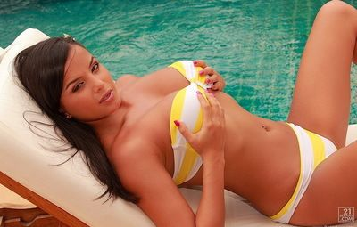 Yellow with an increment of white striped bikini is perfection on young model Sasha Cane
